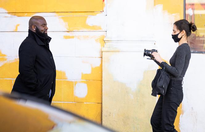 """Director Natasha Florentino, right, films Darlington Ikwuemesibe in a scene for """"Paving a New Way."""" Photo: Courtesy Larkin Street Youth Services"""