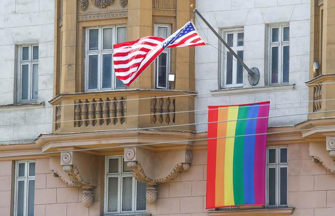 The U.S. flag and an LGBTQ pride flag flew on the front facade of the U.S. Embassy in Moscow last June. Photo: Courtesy Tass