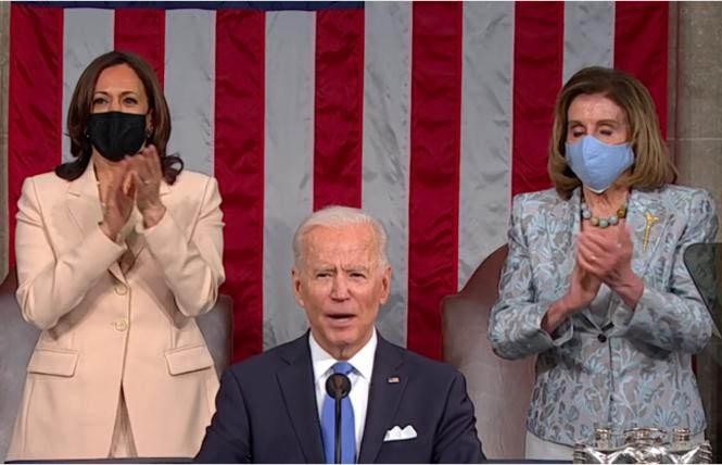 President Joe Biden announced support for the Equality Act during his April 28 speech before a joint session of Congress. Standing behind him were Vice President Kamala Harris, left, and House Speaker Nancy Pelosi. Photo: Screengrab