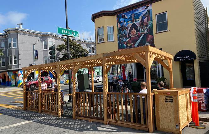 People dine in a parklet outside Dolores Park Cafe. Photo: Liz Highleyman