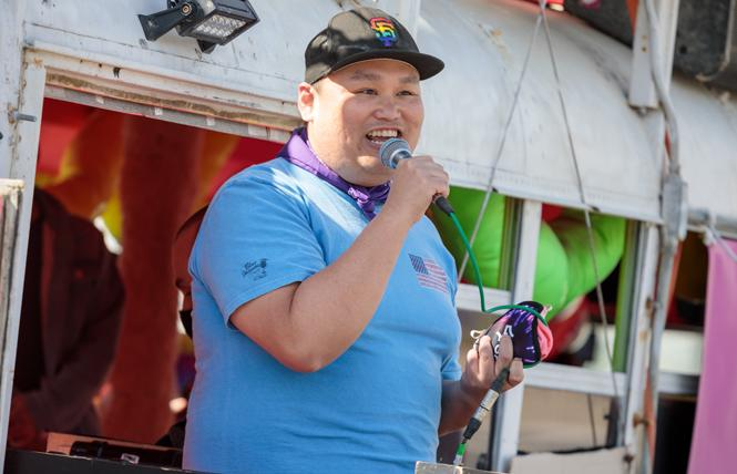 GAPA board chair Michael Trung Nguyen spoke at one of the rallies in the Castro to stand against API hate. Photo: Kevin Zhou
