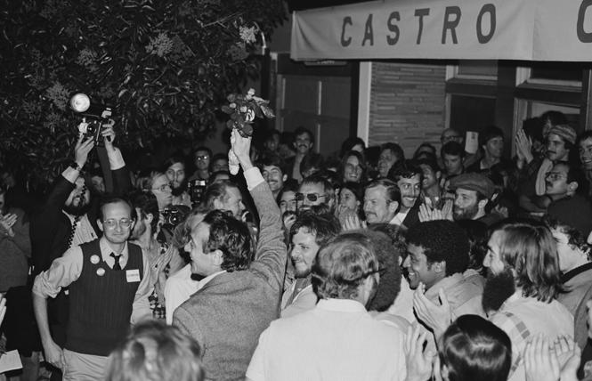Harvey Milk holds a bouquet of flowers and is surrounded by supporters on election night 1977 when he won a seat on the San Francisco Board of Supervisors. Photo: Dan Nicoletta