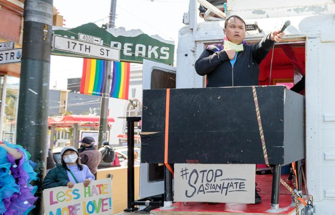 GAPA Chair Michael Trung Nguyen spoke at one of the recent rallies in the Castro against Asian American and Pacific Islander hate. Photo: Kevin Zhou