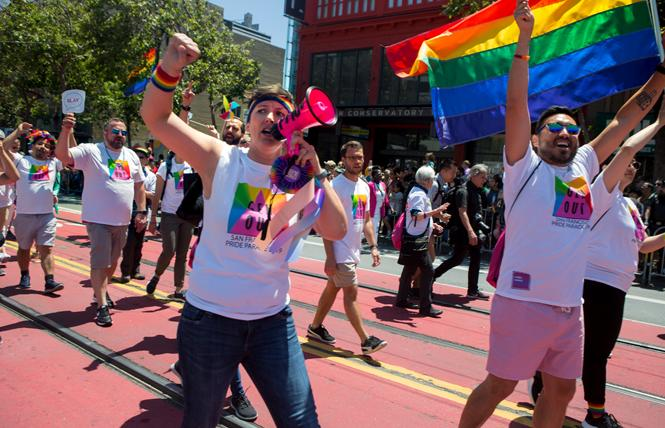 Karyn Skultety, Ph.D., greeted Pridegoers on the Openhouse motorized cable car during the 2019 San Francisco Pride parade. Photo: Saul Bromberger