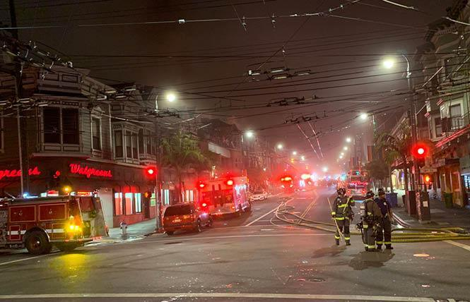 Firefighters mopped up after a four-alarm fire in the Castro November 16, 2019. Photo: Michael Yamashita