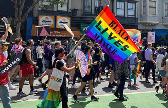 Hundreds of people took part in last year's People's March on Polk Street at California and Pine streets. Photo: John Ferrannini