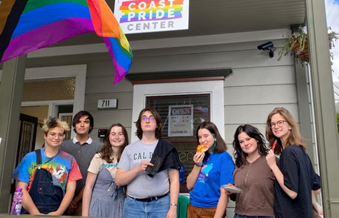 Local young adults who hang out at the CoastPride Community Center include, from left, Novak Chernesky, Joe Torrey, Emily Cooke, Corwin Jones, Jessie Hedger-Walter, Maggie Stack, Gwina Putz, and Bella Forth. Photo: CoastPride Center