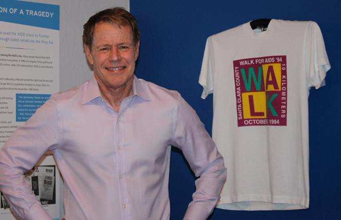 BAYMEC Foundation Executive Director and former Santa Clara County supervisor Ken Yeager stands near a T-shirt from the 1984 Santa Clara County AIDS Walk. Photo: Heather Cassell