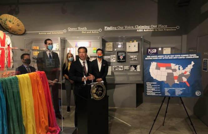 """Attorney General Rob Bonta, at podium, held a news conference at the GLBT Historical Society in San Francisco's Castro neighborhood June 28, where he added five states to California's """"no-fly"""" list. Photo: Matthew S. Bajko"""