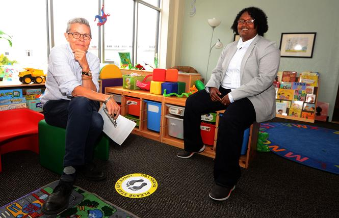 Pauly Pagenhart, left, Our Family Coalition communications director, and Mimi Demissew, executive director, sit in the children's play area in the organization's new offices. Photo: Rick Gerharter