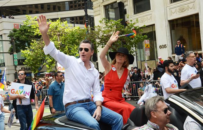 Governor Gavin Newsom and his wife, first partner Jennifer Siebel Newsom, rode in the 2019 San Francisco Pride parade — a first for a sitting governor. Photo: Rick Gerharter