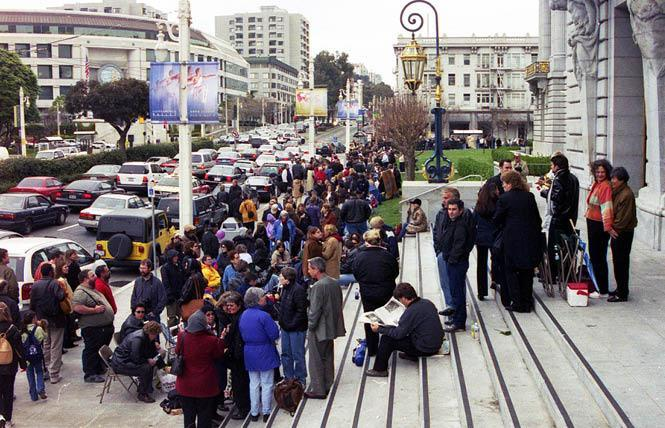 Same-sex couples lined up outside San Francisco City Hall in February 2004 waiting to wed. Those marriages were later voided by the California Supreme Court. Photo: Rick Gerharter