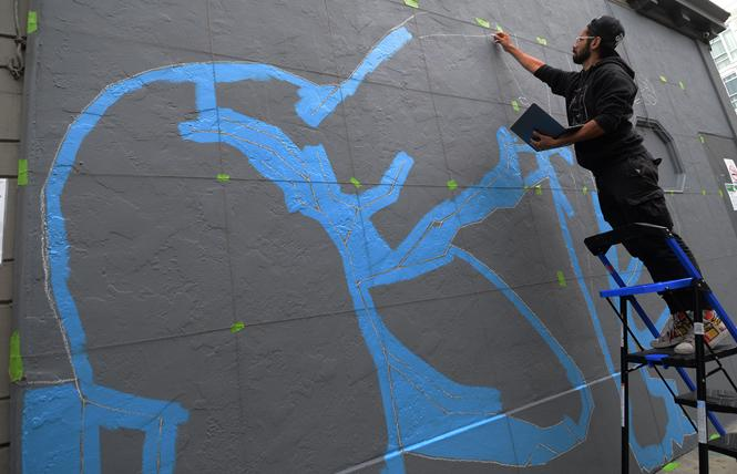 "Artist Simón Malvaez began to paint his mural ""Selfie"" on the alley wall of the Powerhouse bar August 23. Photo: Rick Gerharter"