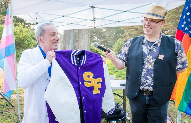Former assemblyman and San Francisco supervisor Tom Ammiano, left, wore his Immaculate Conception letter jacket and was presented with a letterman's jacket by Stephen Saxon on behalf of San Francisco FrontRunners at the Pride Run event in Golden Gate Park Saturday, August 28. Photo: Christopher Robledo