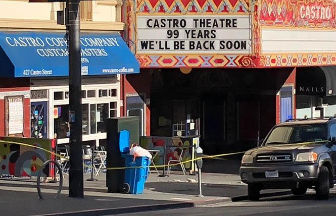 Detritus is observed on the sidewalk of Castro Street after a man allegedly threw the items from the roof of the Castro Theatre. Photo: Matthew S. Bajko
