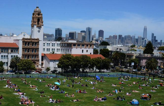 People practiced physical distancing in Mission Dolores Park last spring. Photo: Rick Gerharter