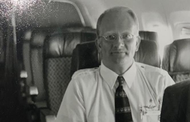 Flight attendant Jeffrey Collman is seated in his favorite plane the 767, which incidentally was the type that he died in, his surviving partner said. Photo: Courtesy Keith Bradkowski
