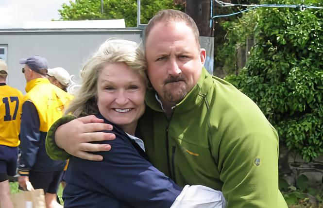 Alice Hoagland, the mother of Mark Bingham, hugged Bryce Eberhart at a rugby match. Photo: Courtesy Bryce Eberhart