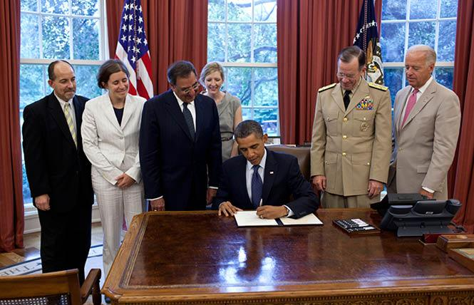 """President Barack Obama signs the certification stating the statutory requirements for repeal of """"Don't Ask, Don't Tell"""" have been met, in the Oval Office, July 22, 2011. Pictured, from left, are: Brian Bond, deputy director of the Office of Public Engagement; Kathleen Hartnett, associate counsel to the president; Secretary of Defense Leon Panetta; Kathryn Ruemmler, counsel to the president; Chairman of the Joint Chiefs of Staff Admiral Mike Mullen; and Vice President Joe Biden. White House photo: Pete Souza"""
