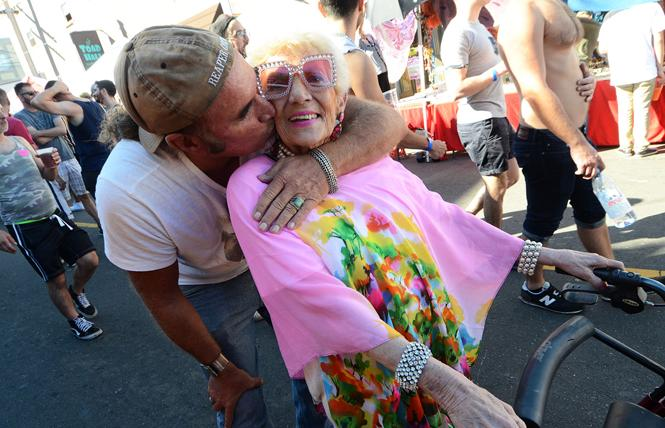 Jim Koran gave his 86-year-old mother, Christina Fast, visiting from Scottsdale, Arizona, a hug and a kiss as they made their way through the crowd at the 2018 Castro Street Fair. Photo: Rick Gerharter
