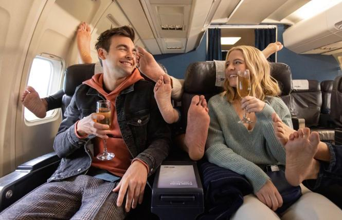 Cary (Drew Tarver) and Brooke (Heléne York) enjoy First Class feet in 'The Other Two.'