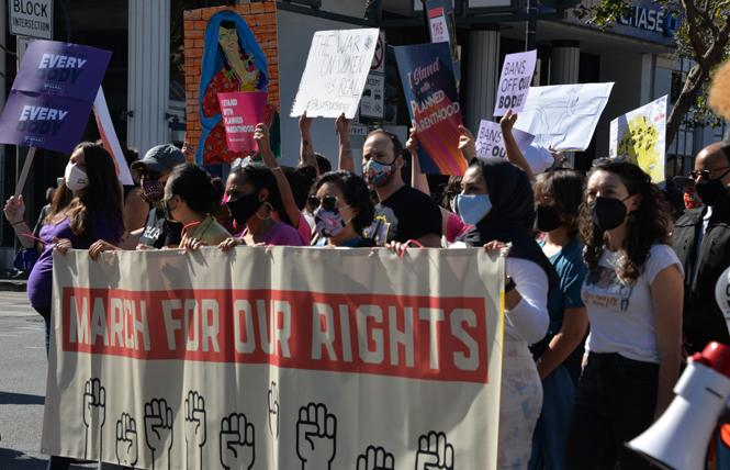 San Francisco District Attorney Chesa Boudin, center, shown here at the October 2 women's march, and his office are working with a nonprofit organization to establish a truth and reconciliation commission. Photo: Bill Wilson