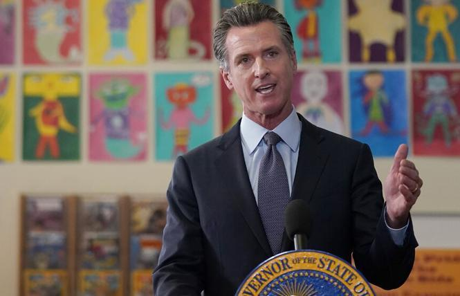 Governor Gavin Newsom signed a bill to allow for trans and nonbinary college students to use their lived names on diplomas and academic records. Photo: Courtesy AP