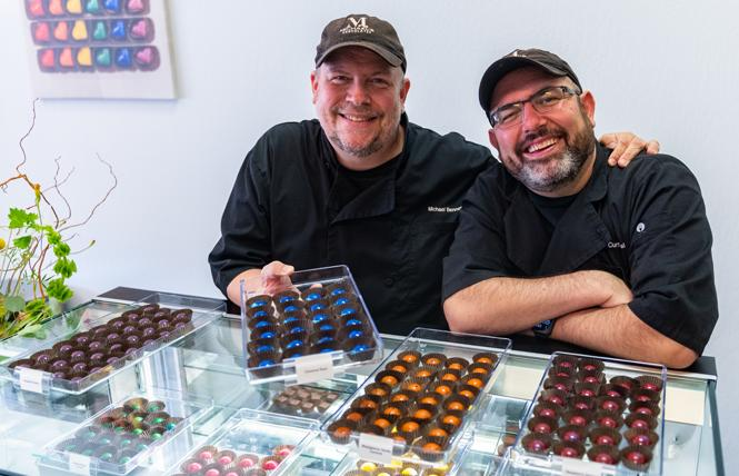 Chocolatier Michael Benner, left, was joined by his husband, Curtis Wallis, at the opening of Michael's Chocolates in Oakland October 2. Photo: Jane Philomen Cleland