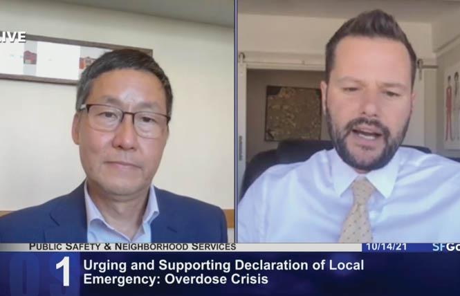 Supervisor Gordon Mar, left, listens as Supervisor Matt Haney talks about his resolution declaring a state of emergency in San Francisco on the drug overdose crisis. Photo: Screengrab