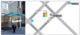 [A person stands infront of a large glass building with the address 725. An adjacent image shows a map locating the Microsoft building between Georgia and Granville]