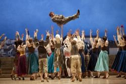 "Allen Galli as Sancho Panza, with Pacific Northwest Ballet company dancers in Alexei Ratmansky's ""Don Quixote"""