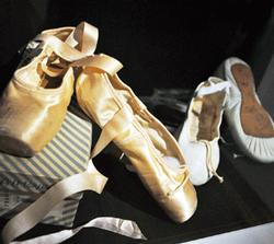 """Margot Fonteyn's ballet slippers and Rudolf Nureyev's rehearsal shoes, on display in the exhibit """"Rudolf Nureyev: A Life in Dance"""" at the de Young Museum.  (Photo: Rick Gerharter)"""