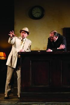 Richard Schiff as Erie Smith and Randall Newsome as Night Clerk i