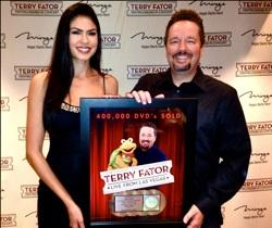 Terry Fator and Taylor Makakoa celebrate a quadruple platinum DVD