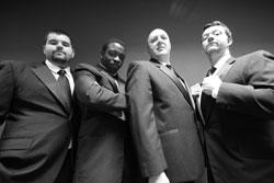 "Patrick Curran, Seyi Ayorinde, Joe Siriani, and James Bocock star in ""Bouncers,"" continuing through April 27 at the Cantab Lounge in Central Square"