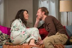 Abby (ensemble member Kate Arrington) and Zack (Cliff Chamberlain) get ready for a date in Steppenwolf Theatre Company's production of 'Belleville' by Amy Herzog
