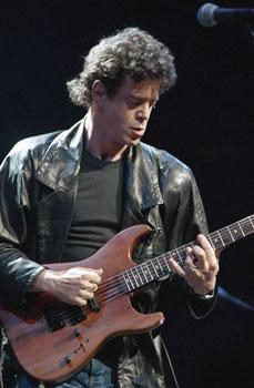 Lou Reed performs during musical number at