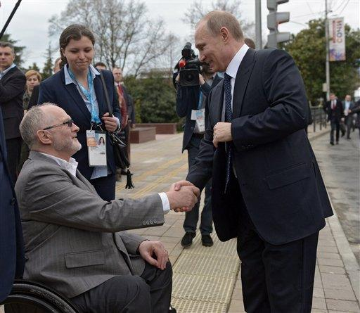 Russian President Vladimir Putin, right, shakes hands with International Paralympic Committee President Philip Craven.