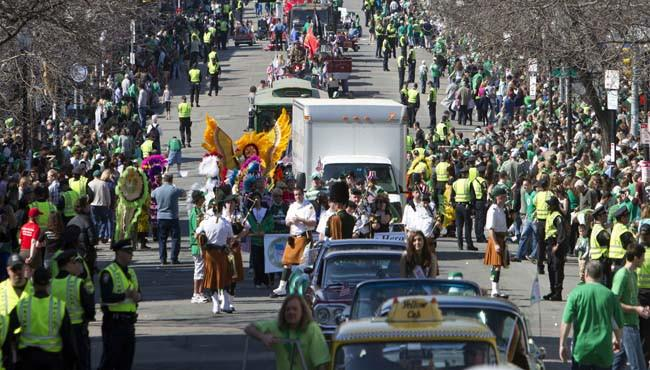 Crowds line the street during the annual St. Patrick's Day Parade in Boston, Sunday, March 18, 2012.