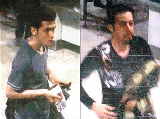 An Iranian identified by Malaysian Police as Pouria Nour Mohammad Mehrdad, who Malaysian authorities say is 19, although Interpol's information indicated an age of 18, left, and 29-year-old Iranian Delavar Seyedmohammaderza.