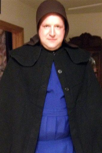 Sgt. Chad Adams of the Pulaski Township Police, dressed as an Amish woman