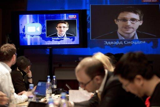 Edward Snowden, displayed on television screens.