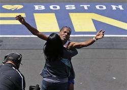Meb Keflezighi, of San Diego, Calif., is hugged after crossing the finish line to win the 118th Boston Marathon Monday, April 21, 2014 in Boston.