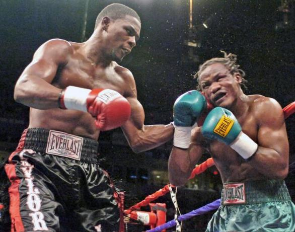 Middleweight champion Jermain Taylor, left, hits challenger Kassim Ouma, in 2006.