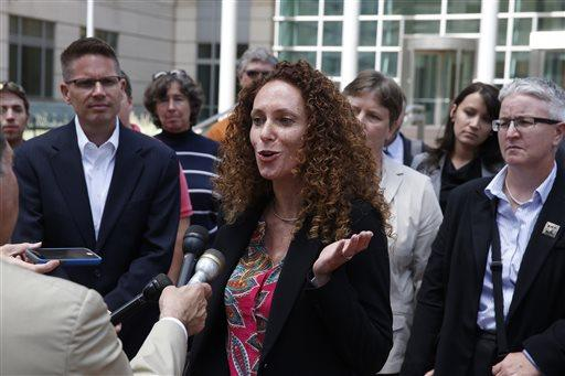 Attorney Mari Newman, center, talks with members of the media, as she stands with her plaintiffs and their supporters following a court hearing on sam sex marriage at the Federal District Court, in Denver.