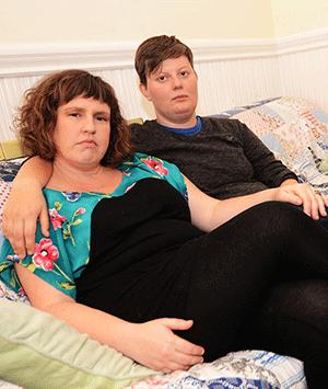 Evicted tenants and partners Alison Panko, left, and Oona Hanawalt sit in their apartment on 25th Street in the Mission.