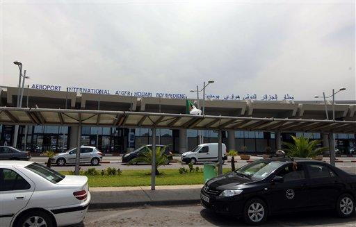 Vehicles are parked outside the Houari Boumedienne international airport near Algiers, Algeria.
