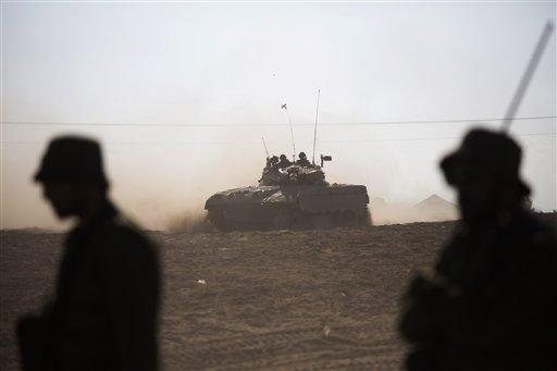 Israeli tank rides near the Israel and Gaza border.