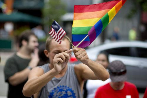 Chaunce O'Connor demonstrates outside the Miami court house during the court hearing on gay marriage in Miami Wednesday