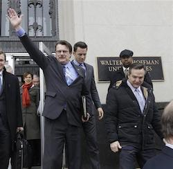 Plaintiff in the Bostic v. Rainey case, Tony London, waves to the crowd as he and his partner, Tim Bostic, right, leave Federal Court